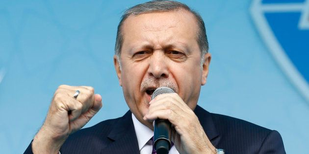 Turkish President Tayyip Erdogan addresses his supporters during a rally for the upcoming referendum...