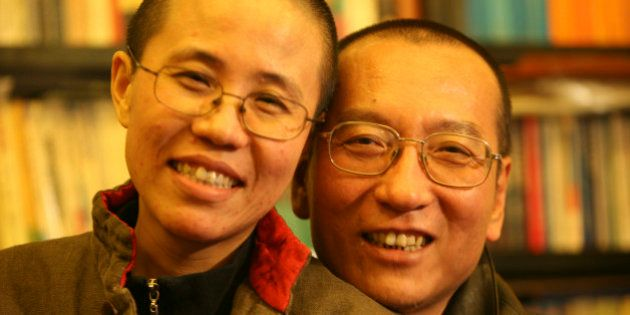 Chinese dissident Liu Xiaobo and his wife Liu Xia pose in this undated photo released by his family on...