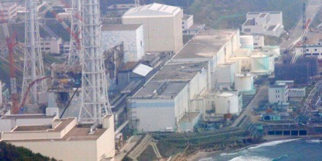 In this aerial photo taken from the Asahi Shimbun helicopter, reactors of the tsunami-stricken Fukushima...