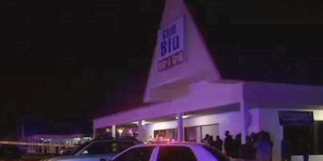 In this frame from video, people gather near the scene of a fatal shooting at Club Blu nightclub in Fort...