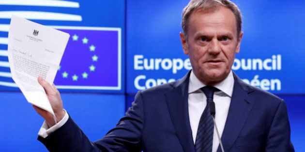 European Council President Donald Tusk shows British Prime Minister Theresa May's Brexit letter in notice...