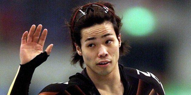 Japan's Hiroyasu Shimizu waves after winning Men's 500 meter of World Speedskating Championships in Nagano,...