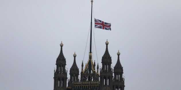 A union flag flies over Parliament at half-mast the morning after an attack by a man driving a car and...