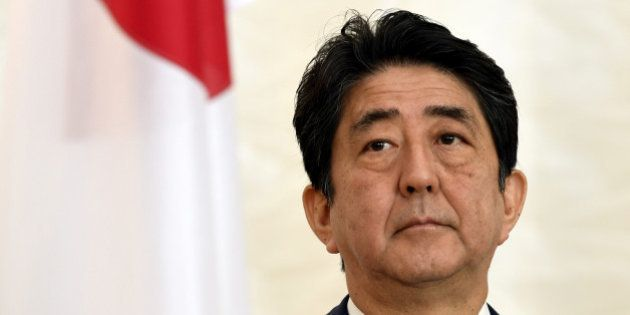 Japanese Prime Minister Shinzo Abe attends a press conference at the Presidential Palace in Helsinki,...