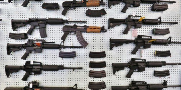 In this July 20, 2014 photo, guns are displayed for sale at Dragonman's, an arms seller east of Colorado...