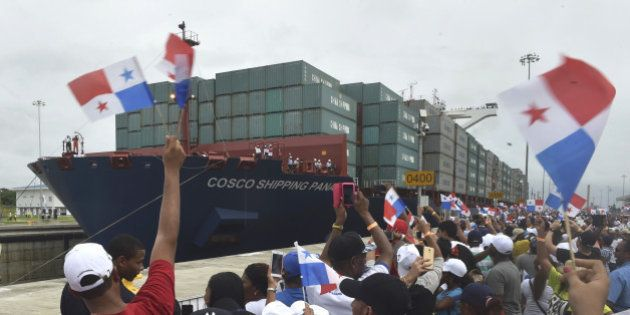 TOPSHOT - Chinese-chartered merchant ship Cosco Shipping Panama crosses the new Agua Clara Locks during...