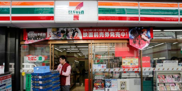 An employee of 7-Eleven works at a convenience store in Tokyo January 8, 2013. Seven & I Holdings Co's...