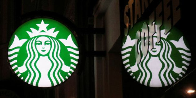 A Starbucks logo is seen at a Starbucks coffee shop in Vienna, Austria, December 27, 2016. REUTERS/Leonhard