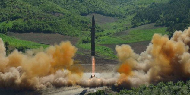 The intercontinental ballistic missile Hwasong-14 is seen during its test launch in this undated photo...