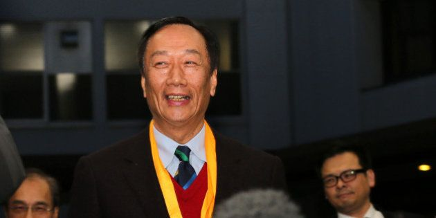 Terry Gou, chairman of Foxconn Technology Group, arrives at a podium before he speaks to media at the...