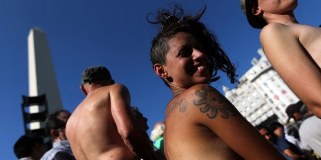 Topless women attend a protest in response to a recent incident on an Argentine resort beach between...