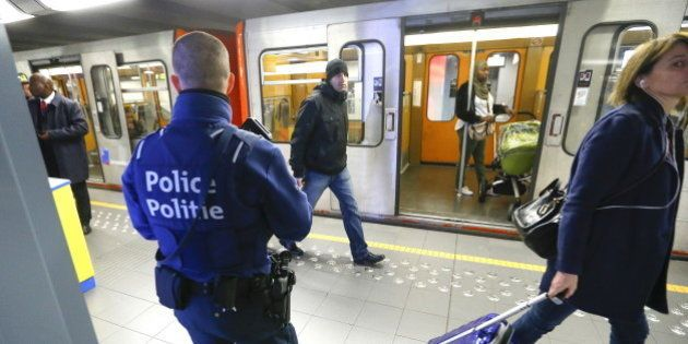 A Belgian police officer patrols in a metro station in Brussels, a week after the bomb attacks at the...