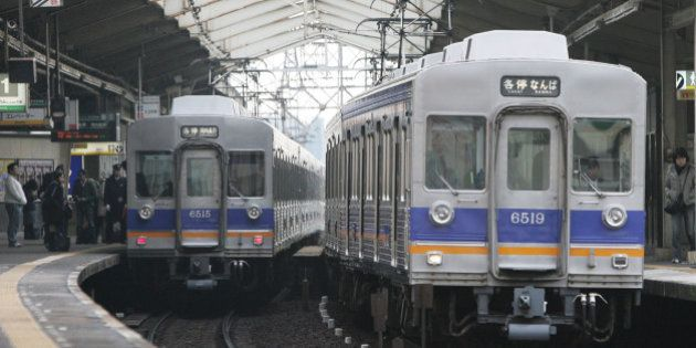 JAPAN - FEBRUARY 05: Nankai Electric Railway Co. trains sit inside the Shin-Imamiya station in Osaka,...