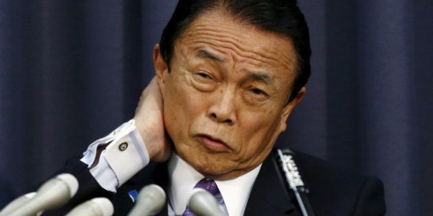 Japan's Finance Minister Taro Aso attends a news conference at the Finance Ministry in Tokyo December...