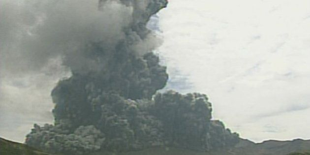 A video grab from the Japan Meteorological Agency's live camera image shows an eruption of Mount Aso...