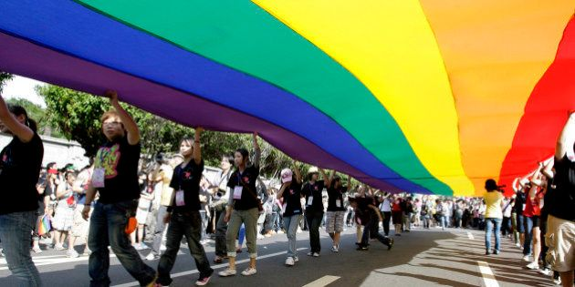 Participants hold a rainbow flag during the Taiwan Gay Pride Parade in Taipei October 31, 2009. Around...