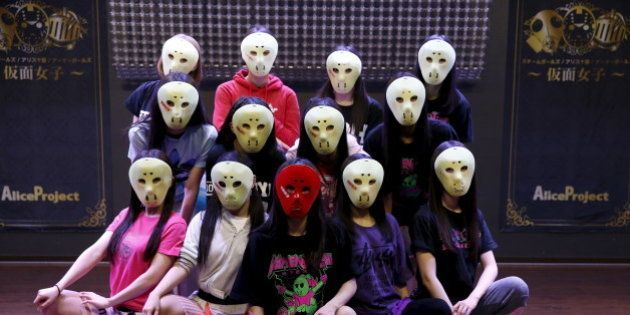 Members of Japanese idol group Kamen Joshi (Masked Girls) pose for a photo after a rehearsal for a concert...
