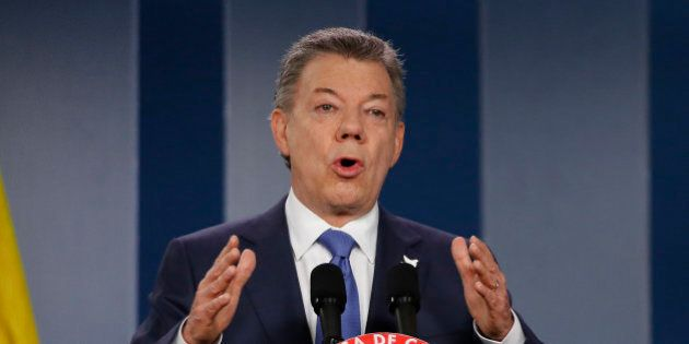 Colombia's President Juan Manuel Santos delivers a statement to the press after meeting with former...