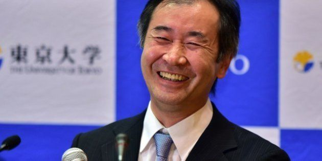 Takaaki Kajita, a professor at the University of Tokyo Institute for Cosmic Ray Research smiles at a...