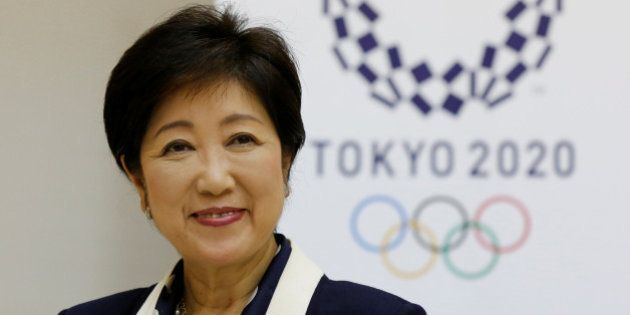 Tokyo Governor Yuriko Koike speaks in front of Tokyo 2020 Olympics emblem during an interview with Reuters...