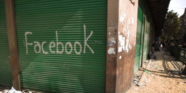 CAIRO, EGYPT - FEBRUARY 04: A shop in Tahrir Square is spray painted with the word Facebook after the...