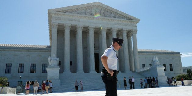 A police officer stands outside the U.S. Supreme Court building after the Court sided with Trinity Lutheran...