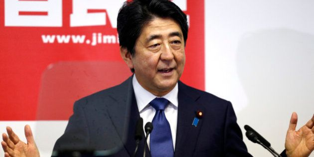 Japanese Prime Minister Shinzo Abe delivers a speech during a press conference at the headquarters of...