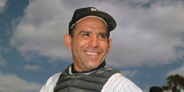 File-New York Yankee catcher Yogi Berra poses at spring training in Florida, in an undated file photo....