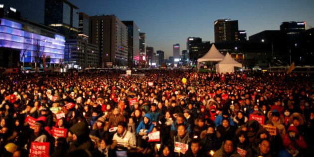 People attend a protest calling for South Korean President Park Geun-hye to step down in central Seoul,...