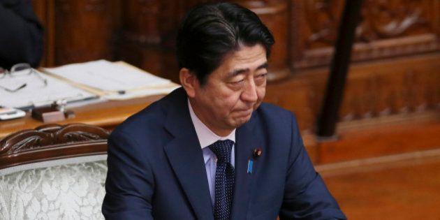 Japanese Prime Minister Shinzo Abe attends the upper house plenary diet session in Tokyo Friday, Sept....