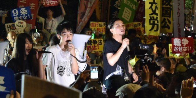 Members of SEALDs (Students Emergency Action for Liberal Democracy - s) stage a rally against Japanese...