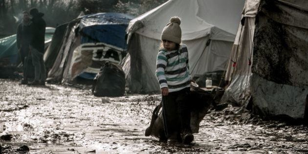 A child walks in the so-called 'Jungle' migrant camp in Gande-Synthe where 2,500 refugees from Kurdistan,...