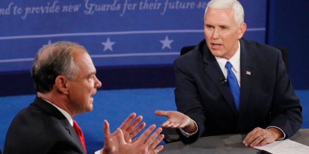 Republican vice-presidential nominee Gov. Mike Pence, right, and Democratic vice-presidential nominee...