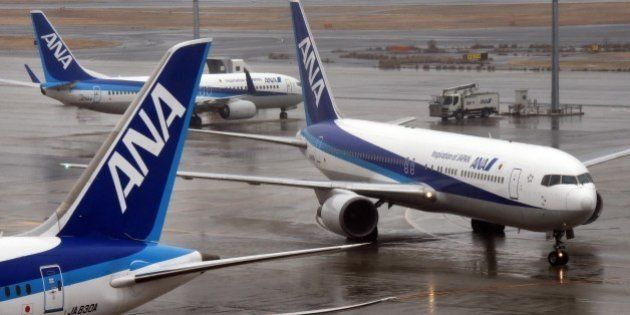 All Nippon Airways (ANA) passenger jets are seen on the runway at Haneda airport in Tokyo on January...