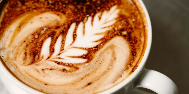 'A delicious cup of cafe mocha espresso on a stainless steel surface, beautifully poured with a signature...