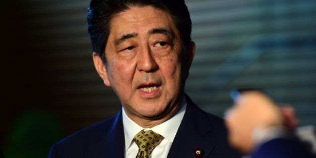 Japanese Prime Minister SHinzo Abe speaks to reporters at his official residence in Tokyo on September...