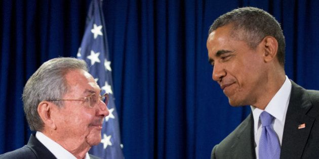 FILE - In this Sept. 29, 2015 file photo, President Barack Obama stands with Cuba's President Raul Castro...