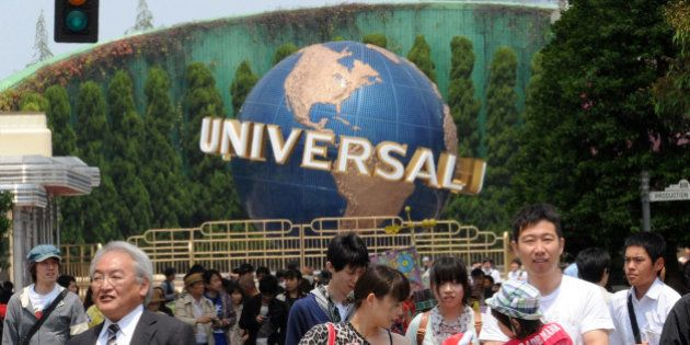 Visitors enjoy a tour at the movie theme park Universal Studios Japan (USJ) in Osaka on May 10, 2012....
