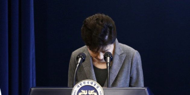 South Korean President Park Geun-Hye bows during an address to the nation, at the presidential Blue House...