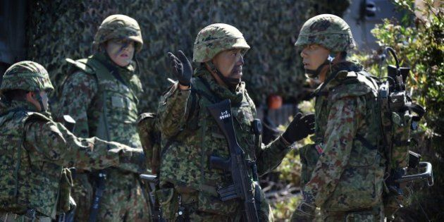 Japanese soldiers prepare during an amphibious landing operation with US Forces and the Japan Maritime...