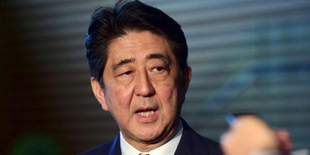 Japanese Prime Minister SHinzo Abe speaks to reporters at his official residence in Tokyo Tuesday, Sept....