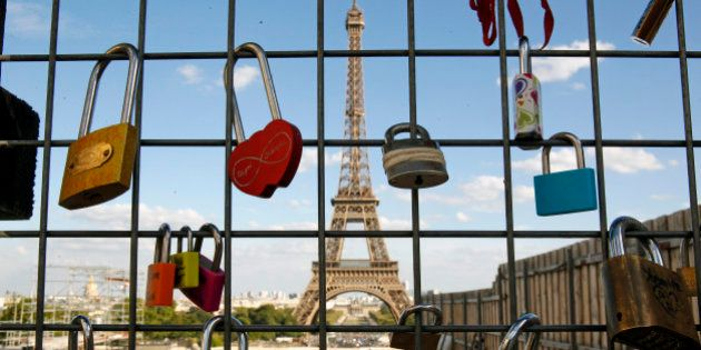 PARIS, FRANCE - SEPTEMBER 01: Love padlocks are seen in front of the Eiffel tower on September 1, 2016...