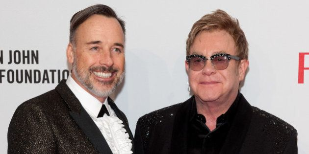 NEW YORK, NY - OCTOBER 28: Elton John (R) and David Furnish attend the Elton John AIDS Foundation's 13th...