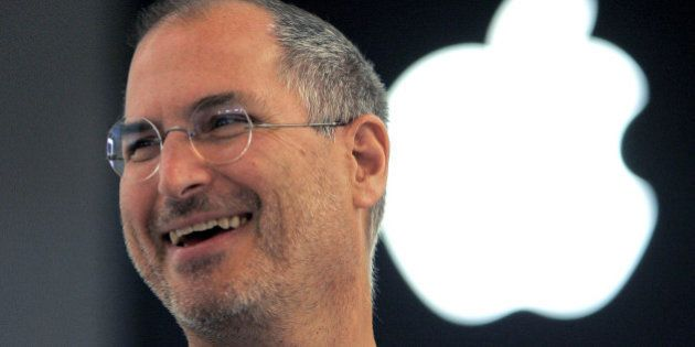 FILE - In this Sept. 20, 2005 file photo, Apple co-founder Steve Jobs smiles after a press conference...