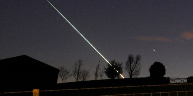 A meteorite creates a streak of light across the night sky over the North Yorkshire moors at Leaholm,...