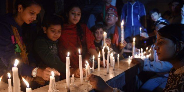 Activists of Pakistan Tehreek e Insaaf (PTI) light candles for the victims of an attack by Taliban gunmen...