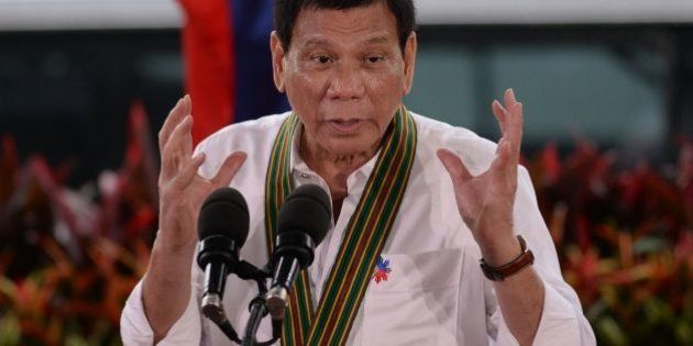 Philippine President Rodrigo Duterte gestures as he delivers a speech during a 'talk to the troops' visit...