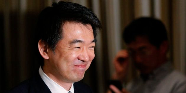 Osaka Mayor Toru Hashimoto leaves a news conference at the Foreign Correspondents' Club of Japan in Tokyo...