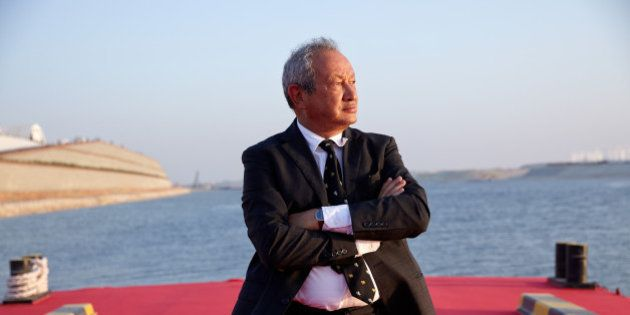 Egyptian billionaire Naguib Sawiris poses for a photograph on a floating pontoon in front of the New...