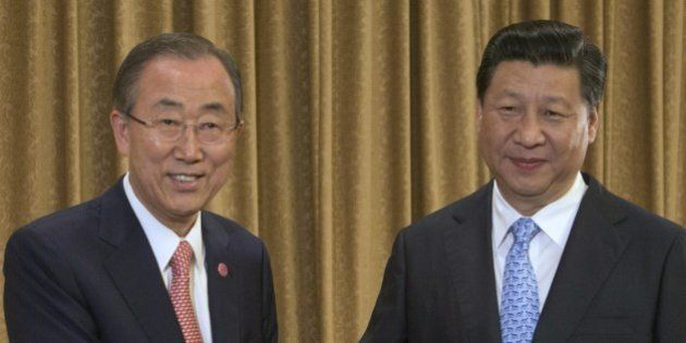 UN Secretary-General Ban Ki-moon (L) and Chinese President Xi Jinping (R) face the media during a ceremonial...